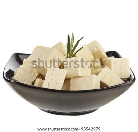 Tofu cubes  on black plate bowl  isolated on white