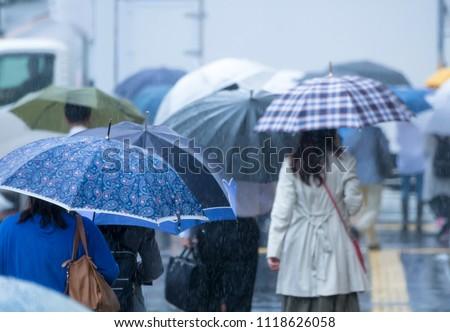 Tokyo commuting · rainy day · June