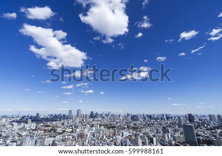 Tokyo urban landscape Overall view White clouds flowing in the blue sky #599988161