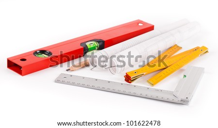 tools and construction plans on white background