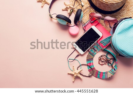 Top view of essential modern young lady or girl on vacations.Woman\'s summer holidays accessories composed on pastel color background. Beach fashion , summer concept. Trendy colors.
