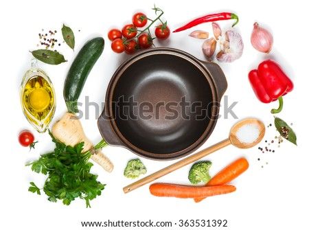 Top view of open pan, fresh raw vegetable and spices for soup isolated on white background #363531392