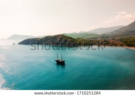 Top view of the lagoon with yachts near the old town of Fazelis. Beautiful park and mountains on the Mediterranean coast. Other reserve on a sunny day. tourist attraction and top places in Turkey
