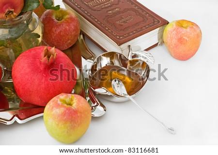 torah, ripe apple  and honey for Rosh Hashana– jewish new year
