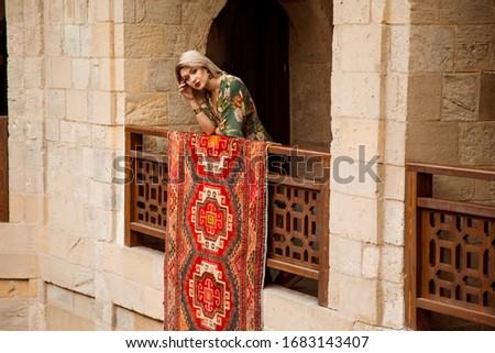 tourist girl on holiday in Baku old city. Pretty tourist girl on the street of the old town.Baku, Azerbaijan. Tourist concept. Photo of young tourist girl exploring streets of Baku