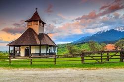 Traditional easy mountain Monastery and stunning sunset,Bran,Transylvania,Romania,Europe