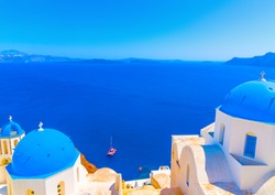 2 Traditional old churches with blue colored domes in Oia the most beautiful village of Santorini island in Greece