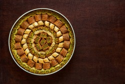 Traditional turkish, arabic sweets baklava assortment with pistachio. Top view, copy space