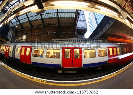 Train arriving at subway station in London, UK