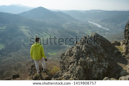 Traveler relax on the edge rock. Nature and adventure composition. Sharp exposed sandstone hills. Leisure activity. Sport tourism. Adventures of hikers #1419808757