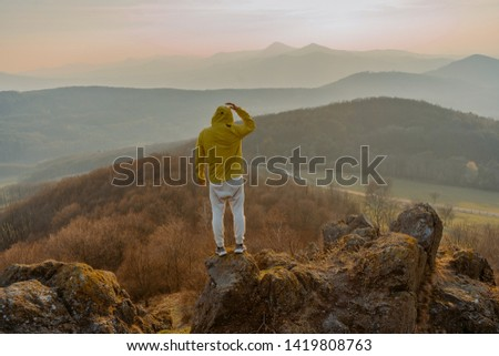 Traveler relax on the edge rock. Nature and adventure composition. Sharp exposed sandstone hills. Leisure activity. Sport tourism. Adventures of hikers #1419808763