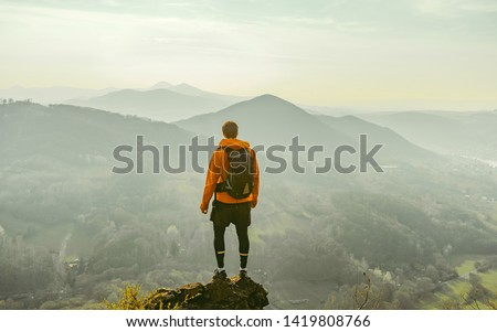 Traveler relax on the edge rock. Nature and adventure composition. Sharp exposed sandstone hills. Leisure activity. Sport tourism. Adventures of hikers #1419808766