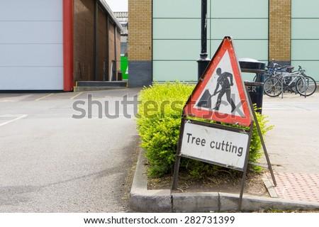 \'Tree cutting\' safety warning sign  closeup
