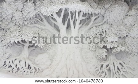 Tree sculpture on the wall thailand.