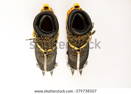 trekking shoes, crampons for mountaineering, isolated on white. Top view. Climbing equipment #379738507