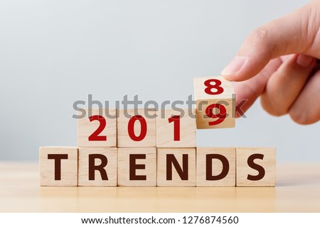 2019 trend concept. Hand flip wood cube change year 2018 to 2019