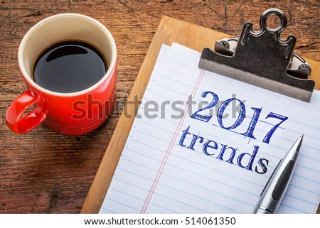 2017 trends on a  clipboard with coffee against grunge wood desk #514061350