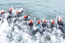 triathlon competitors in swim , triathletes in action and motion