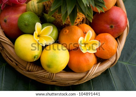 Tropical fruit basket  and tropical flowers