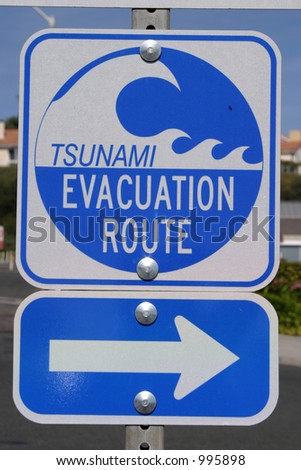 """Tsunami"" evacuation route sign with arrow pointing right"