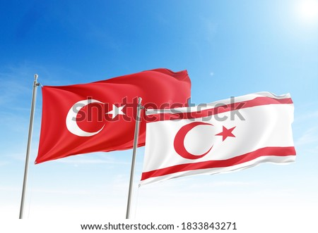 Turkey and Turkish Republic of Northern Cyprus flags waving in the dawn sky