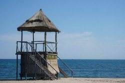 turret with reed roof installed on the beach in Vama Veche. photo during the day.