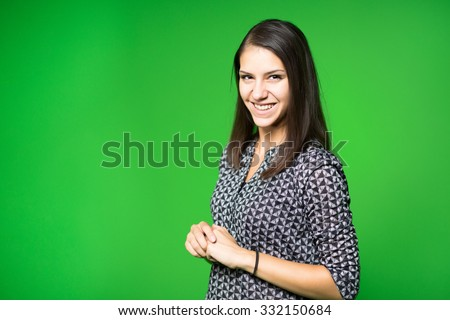 TV weather news reporter at work.News anchor presenting the world weather report.Television presenter recording in a green screen studio.Young woman with copy space on green screen chroma key