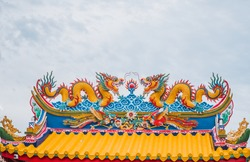 twin dragon on chinese temple roof.  Chinese Dragon On China Temple Roof.  Roof Decoration of Ancient Chinese architecture