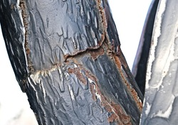twisted pole metal,   rusty metal texture,  deep fracture of metal with peeling paint, Concept of anti-corrosion painting.