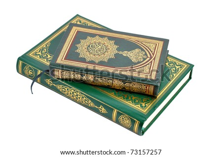 Two books of the holy Quran isolated on white - stock photo