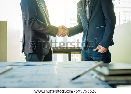 two businessmen shaking hands...