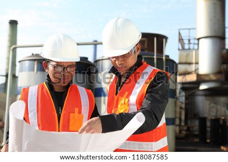 two engineer checking a drawing