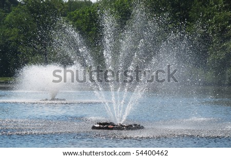 two fountains in pond - stock photo