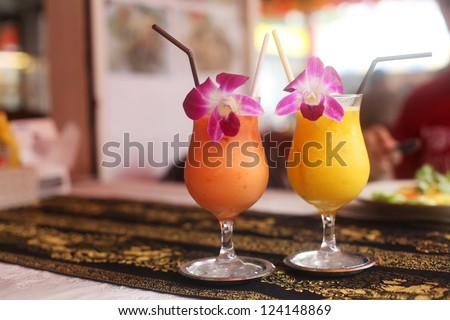 two fresh juiceson the beach on the table