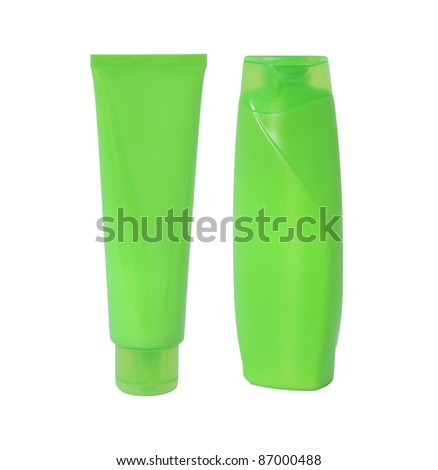 Two green bottles of shampoo isolated on white background