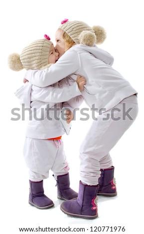 Two little girls embrace