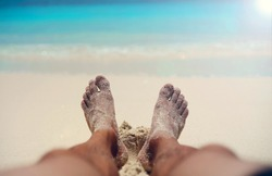 Two men's legs and (PO V) ocean view