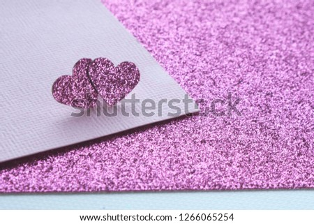 two shiny pink hearts on an abstract textural pink and shiny pink background #1266065254