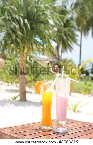 Two tropical cocktails near beach - stock photo