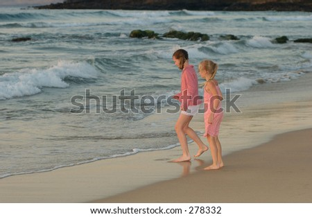 """ Two young girls standing on a beach, Big Island, Hawaii, (Keith Levit)"""