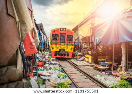 Umbrella market Maeklong Railway Train Market in Maeklong Samut Songkhram Thailand
