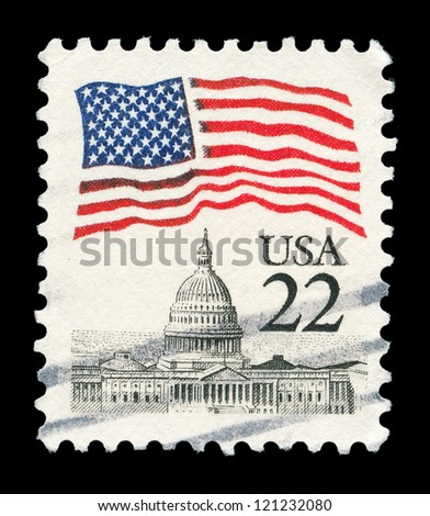 UNITED STATES - CIRCA 1985: A post stamp printed in the United States, features waving US flag and Capitol, circa 1985