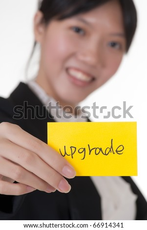 """Upgrade"" on business card holding by Asian businesswoman."