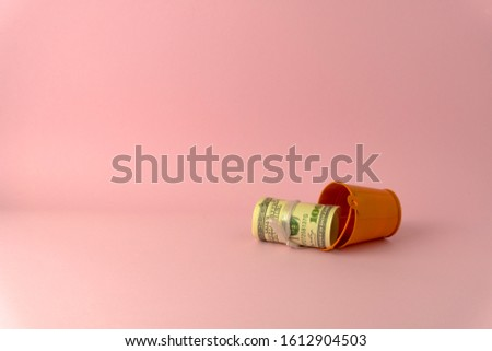 100 USD roll inside small bucket  isolate on pink color background space use as online shopping business concept