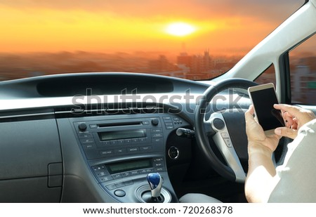 Using a smartphone while driving or use cell-phone connect to intelligent car #720268378