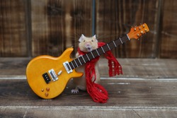 Сute mouse plays guitar, sings. Fun pet fond of music. Talented animal: home musician. Musical mouse celebrate. Mouse rock star on stage gives concert. Postcard with mouse. Talent, song. Celebration