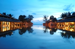Vacation resort at the beach in Thailand, captured in the sunset.