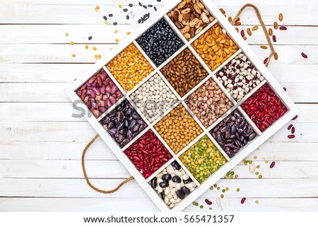 Variety of legumes, range, in a white wooden box with cells, peas, green peas, corn, beans, lentils. Top view. Stock photo ©