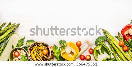 Variety of organic vegetables ingredients with asparagus and feta for delicious seasonal cooking , white wooden background, top view, place for text, banner #566495551