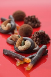 Various chocolates with fresh cacaos